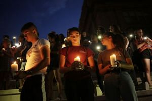 Mourners take part in a vigil at El Paso High School after a mass shooting at a Walmart store in El Paso, Texas, US on Aug 3, 2019.