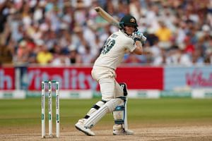 Australia's Steve Smith reacts as he is caught out by England's Jonny Bairstow off the bowling of Chris Woakes.