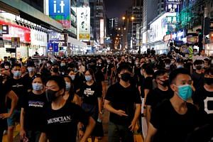 Anti-extradition bill protesters marched in Hong Kong's tourism district at Nathan Road near Mongkok on July 7, 2019.