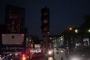 A street in Jakarta covered in darkness yesterday as traffic lights stopped working during the power outage, causing chaos at some locations. Some motorists and bus passengers resorted to using cash instead of cards for payment as unmanned toll gates