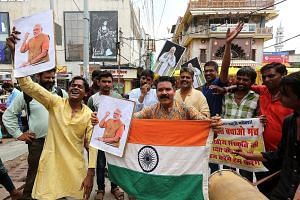 BJP supporters celebrating in Bhopal following reports that the government has revoked the special status given to Indian-administered Kashmir.