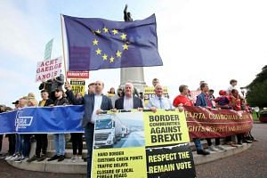 Anti-Brexit demonstrators protest outside Stormont house as Britain's Prime Minister Boris Johnson visits Belfast, Ireland on July 31, 2019.