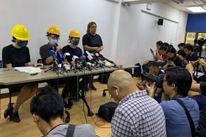 The three activists, who declined to give their real names, held the news conference in the Mong Kok neighbourhood of Hong Kong on Aug 6.