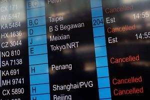 An information screen showing cancelled flights at Hong Kong International Airport on Monday, Aug 5, 2019.