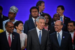(From left) Home Affairs and Law Minister K. Shanmugam, Prime Minister Lee Hsien Loong and UN Assistant Secretary-General for Legal Affairs Stephen Mathias pictured during the signing ceremony on Aug 7, 2019.