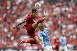 In a picture from Aug 4, 2019, Liverpool's Roberto Firmino (left) is seen in action against Manchester City's Oleksandr Zinchenko (right) during the FA Community Shield match at Wembley Stadium in London.
