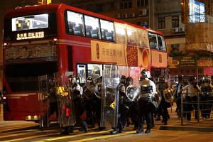 Policemen in riot gear arrive to disperse the residents and protesters at Sham Shui Po district in Hong Kong on Aug 6, 2019.