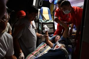 An injured man is seen in an ambulance on Aug 7, 2019, amid the raid by members of the Kyrgyz special forces.