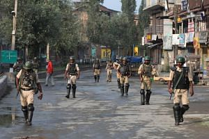 Thousands of paramilitary police have been deployed in Srinagar, schools shut and roads and neighbourhoods barricaded.