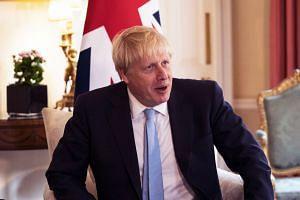 Johnson meets King Abdullah II of Jordan at 10 Downing Street in London.