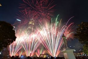 Fireworks at the Singapore River behind the statue of Sir Stamford Raffles during the National Day Parade, on Aug 9, 2019.