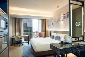 Rooms at Capri by Fraser, China Square depict Chinatown's shophouses on a mural and overlook a similar view.