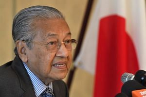 Prime Minister Mahathir Mohamad reportedly said the 600 Malaysian employees at the plant in the state of Pahang were not afraid to keep working there.