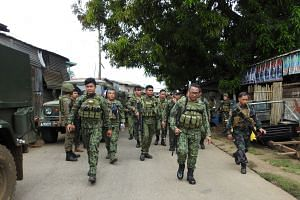 Officials and police staff heading for Indanan town, Sulu, on June 28 to conduct an investigation. A blast had left eight people dead and 12 wounded. Militants are seeking to bomb targets in Luzon, and with other threats, such as some 200 Indonesians
