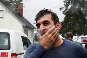 Mosque board member Irfan Mushtaq reacts after the shooting.