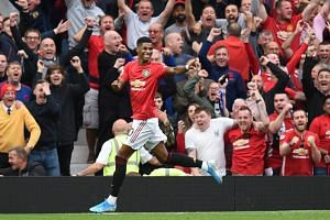 Manchester United's English striker Marcus Rashford celebrates after scoring their third goal during the English Premier League football match between Manchester United and Chelsea at Old Trafford in Manchester, north west England, on Aug 11, 2019.