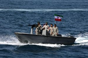 """In this photo taken on April 30, 2019, Iranian soldiers take part in the """"National Persian Gulf day"""" in the Strait of Hormuz."""