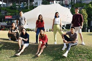 The Sept 21 event is the brainchild of environmental studies student Lad Komal Bhupendra (standing, in red), 19. Her co-organisers include (clockwise from far left) Ms Annika Mock, 20; Mr Aidan Mock, 24; Ms Tan Heng Yeng, 23; Mr Elwin Lim, 24; Mr Kri