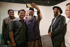Deputy Prime Minister Heng Swee Keat (second from left) with representatives of different faiths - (from left) Mr P. Sivaraman, Reverend Gabriel Liew, Mr Mohd Rafeeq Mohd Yussof, Rabbi Netanel Rivni and Monsignor Philip Heng - at the launch of Temase