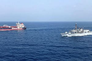 In a photo taken on July 25, 2019, the HMS Montrose (right) accompanies the vessel Stena in the Gulf. Several maritime incidents - including oil tankers being attacked and Iran seizing a British-flagged ship - have occurred in or near the Strait of H