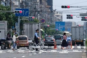 Soaring temperatures have killed at least 57 people across Japan since late July, highlighting the possible health threat to athletes and fans.