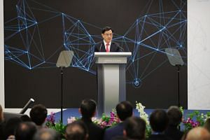 Deputy Prime Minister Heng Swee Keat delivers his speech at the grand opening ceremony of Micron's Singapore new and expanded facility on Aug 14, 2019.