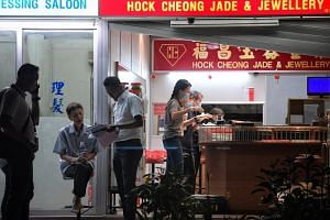 Police investigating the Hock Cheong Jade and Jewellery shop at 574 Ang Mo Kio Ave 10 where a robbery happened on Aug 14, 2019.