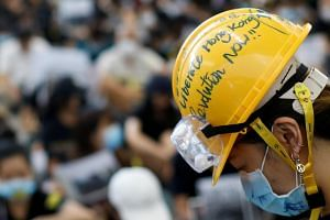 A protester wearing a helmet during a demonstration at the arrival hall of Hong Kong International Airport, on Aug 9, 2019.