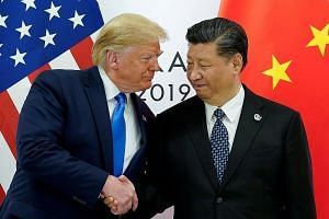 US President Donald Trump and China's President Xi Jinping at the Group of 20 summit in Japan, in June. Both leaders are desperate not only to