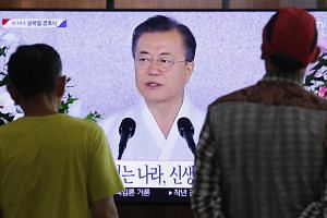 People watching a live broadcast of South Korean President Moon Jae-in's speech during a ceremony marking the 74th anniversary of Korea's liberation from Japanese colonial rule at the end of World War II on Aug 15, 2019.