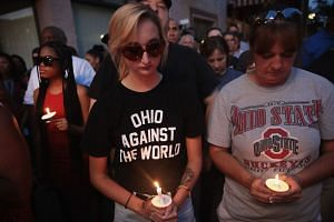 Mourners attend a memorial service for victims of the shooting.