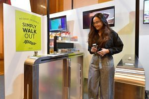 A guest at an unmanned booth by Pick & Go at this year's Singapore Retail Industry Conference and Exhibition.