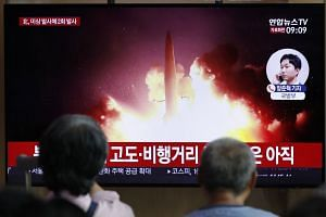 People watching a TV news programme using a file image to report the firing of projectiles by North Korea, at the Seoul Railway Station in Seoul, South Korea, on Aug. 16, 2019.