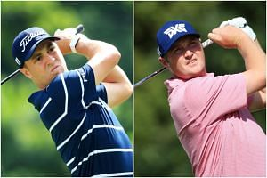 Justin Thomas (left) and Jason Kokrak, who are currently sharing the first-round lead at the BMW Championship.
