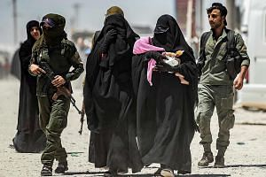 A security patrol escorting women last month at the al-Hol camp, where the Islamic State in Iraq and Syria (ISIS) now exerts more influence and control than the few dozen Kurdish Syrian Democratic Forces guards stationed there, according to US offici
