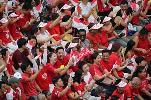 Spectators at the National Day Parade at the Padang on Aug 9, 2019.