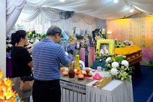 Friends and relatives of Madam Puah Geok Tin paying their last respects at the wake held in the void deck of her home in Tampines Street 12 on Aug 17, 2019.