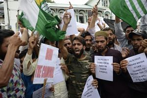 Protesters in Srinagar shouting slogans at a rally on Aug 16, 2019, to denounce the Indian government's move to strip Jammu and Kashmir of its autonomy and impose a communications blackout.