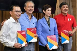 (From left) Permanent Secretary for Manpower Aubeck Kam, Singapore National Employers Federation president Robert Yap, Manpower Minister Josephine Teo and NTUC secretary-general Ng Chee Meng with copies of a report by the Tripartite Workgroup on Olde