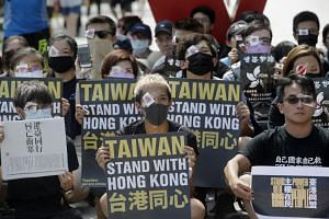 In a picture taken on Aug 17, 2019, Hong Kong students living in Taiwan and Taiwanese supporters wearing symbolic eyepatches and holding slogans gather to support Hong Kong's protesters.