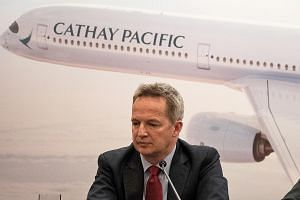 The resignation of Cathay Pacific CEO Rupert Hogg, seen here at a news conference in March, was first announced by China's state-run media last Friday. It came after the Chinese government accused the airline of endangering flight safety when some of