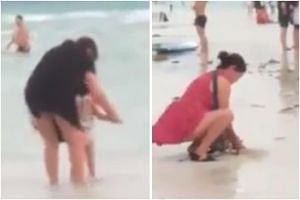 A viral video showing a woman letting a toddler poop near the shoreline at Boracay and another burying the child's soiled underwear in the sand.