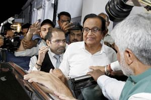 P Chidambaram (second right) leaves after addressing a press conference at Congress party headquarters in New Delhi.