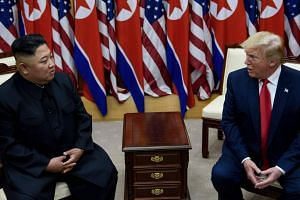 In this photo taken on June 30, 2019, North Korea's leader Kim Jong Un (left) and US President Donald Trump meet at the Joint Security Area of Panmunjom in the Demilitarized Zone.