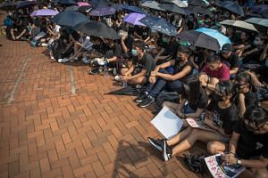 Secondary school students attending an anti-government rally at Central, in Hong Kong, on Aug 22, 2019.