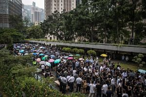 Hong Kong's accountants march in support of the pro-democracy movement at Chater Garden in Hong Kong on Aug 23.