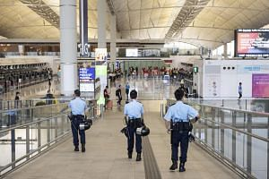 Policemen on duty at Hong Kong's international airport, on Aug 14, 2019.