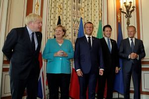 (From left) Britain's Prime Minister Boris Johnson, German Chancellor Angela Merkel, French President Emmanuel Macron, Italy's acting Prime Minister Giuseppe Conte and president of the European Council Donald Tusk pose during a G-7 coordination meeti