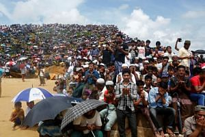 Rohingya refugees take part in a prayer as they gather to mark the second anniversary of the exodus at the Kutupalong camp in Cox's Bazar, Bangladesh, on Aug 25, 2019.