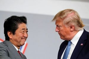 US President Donald Trump and Japan's Prime Minister Shinzo Abe hold a bilateral meeting during the G-7 summit in Biarritz, France, on Aug 25, 2019.